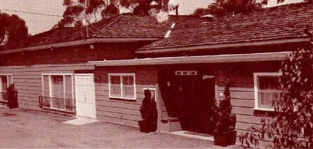 This picture shows the original one story building, which was built out of natural redwood. The current building sits on the same footprint as this original building.